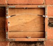 Framed in cherry wood