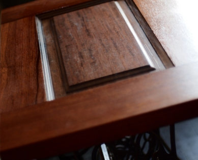 The top has a recessed piece of double strength glass,