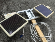Reclaimed solar panels collect the daytime energy. Mounted on scrapyard aluminum.