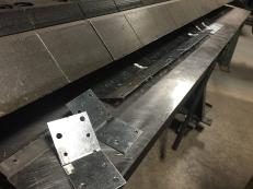 Custom bent hardware on the metal break.