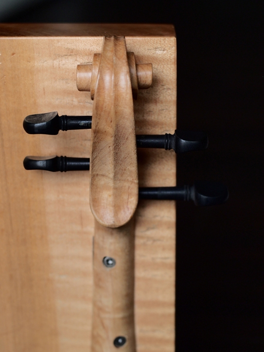 """Refurbished, re-carved violin necks, curly maple. 13"""" x 14 1/4"""" x 10"""""""