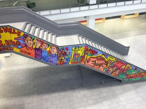 Amina Robinson's painting on the staircase of the Columbus Metropolitan Library