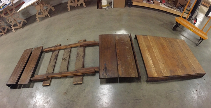 Disassembling a table from the late 1800s to be used as the main body of this sculpture.
