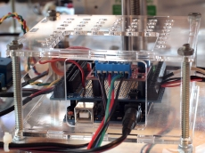 Side view of Arduino, Screwshield, & Big Easy Driver in a custom designed laser-cut enclosure.