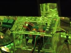 Green light shines on an Arduino + Adafruit Screwsheild + Big Easy Driver board.