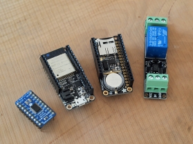 Left: Adafruit TXB0108 logic level Shifter. Middle Left: Adafruit Huzzah32 Feather ESP32 Wi-Fi board. Middle Right: Adafruit Adalogger + RTC. Right: 3.3V relay switch