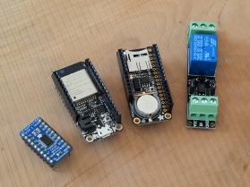 Left: Adafruit TXB0108 logic level Shifter. Middle Left: Adafruit Huzzah32 Feather ESP32 Wi-Fi board. Middle Right: Adafruit Adalogger + RTC. Right: 3.3V relay switch