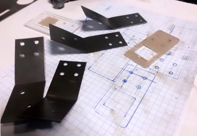 Hand making metal brackets for motion sensor